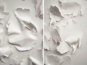 Angèle Guerre, plasticienne, 2018, «Les Mues». Papiers incisés au scalpel et clous. Les mues sont des formes mutantes tirées du travail « Tendre texte ». Ce sont des peaux de papier presqu'animales. Épinglées là, elles dansent.