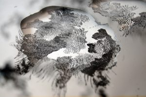 "Angèle Guerre, artist, 2015 to 2016, ""Miroir, Etain"", dimensions 91,5cm x 125 cm. Pewter mirror, paper and Chinese ink. By removing the material, the artist makes layers of landscape appear. His work is a form of archaeology. She digs into the material to reveal different strata of a purely mineral and vegetal world."