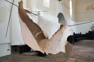 "Angèle Guerre, artist, 2019, ""Souples, un souffle"", dimensions 2m x 4m. Installation of metal, leather and incised paper. Installation realized within the context of the creative residency at the Chapelle des Pénitents Blancs de Vence."