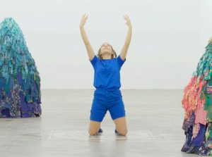 """Emilie Faïf, plastic artist, June 2021, creation of textile sculptures for the performance """"MU"""" by the choreographer Marion Muzac. The dancer Aimée-Rose Rich evolves with softness and humor in an enigmatic universe populated with virtual, sports, and sometimes ancestral references. © photo Edmon Carrère"""