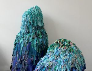 """Emilie Faïf, plastic artist, June 2021, creation of textile sculptures for the performance """"MU"""" by the choreographer Marion Muzac. Tied one by one, these fragments of fabric draw pointillist and hypnotic silhouettes navigating between past and future."""