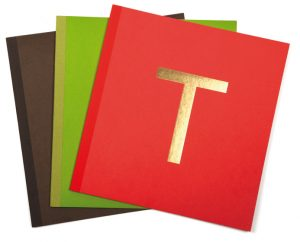 Paper used is a watermark paper with the gold letter T printed on each menu.