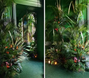 """Marianne Guedin, vegetal scenography, """"Jungle"""", September 2021, Hôtel particulier, Paris. Playing with trompe l'oeil, the palms and flowers bring the spectator into the universe of Douanier Rousseau."""