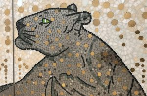 Mathilde Jonquière, mosaic artist, may 2019, Cartier Serrano store, Madrid. The golden dressed panther, totemic attribute of Jeanne Toussaint, is a part of the pictorial history of the House. Sovereign, the panther stares directly at the majestic peacock eyes.