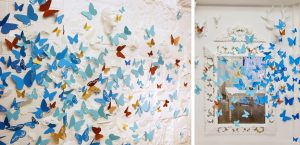 October 2018 – MOROCCANOIL. Composed of plumes and paper, the photocall of the event is covered with hundreds of butterflies in the color of the Color Complete line and of different shapes, that seem to escape.