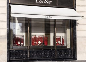 Soline d'Aboville, scenographer, January 2020, Chinese New Year,  Cartier windows, Champs Elysées flagship. For the 2020 Chinese New Year celebrations, Soline d'Aboville draws the windows display for the House Cartier by directly inspiring from the Chinese lanterns. These revisited lanterns become a strong graphic item that adorn the frontages.