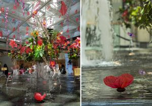 "Falling from the ceiling, the creepers overhang six ""garden blocks"" floating above the fountain water of the Landmark Mall – Hong Kong – June 2018. Upcycling artist."