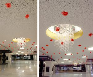 "April 2019. Installation ""Printemps Suspendu"" at the Palais des Congrès in Paris. William Amor designs an artistic installation in the main hall of the Palais des Congrès in Paris. ""Suspended Spring"" or how the metamorphosis of plastic pollution into flowers creates an aerial ballet of poppies flowers."