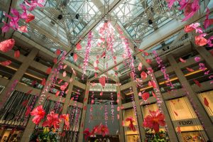 William Amor, upcycling artist, June-July 2018, suspended art installation. William Amor creates a suspended art installation in situ for Landmark Hong Kong's mall. This artwork is composed of petals and flowers made of recycled plastic bags.