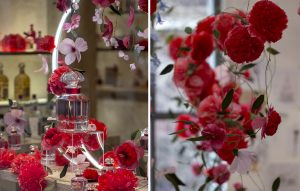William Amor, upcycling artist, floral creation for the launching of Mon Guerlain, Bloom of Rose fragrance, March 2020. Guerlain windows of 68, Champs-Elysées store. These materials blossom into flowers in shades of intense red and pastel pink.